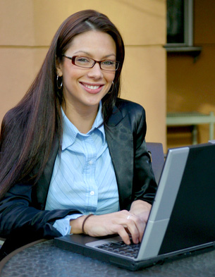 Smiling lady with laptop taking DTA traffic school course on the web