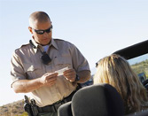 Florida driver receiving speeding ticket from FHP officer