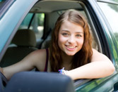 Teen California driver smiling because she just got her California driver license
