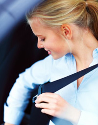 DTA customer who is wearing her seat belt now after taking Texas seat belt course