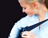 Woman locking her seat belt into place
